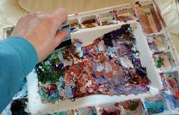 scraping paint with card